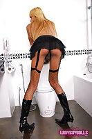 Blonde ladyboy in black stockings