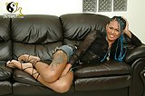 Jerking off on a leather sofa