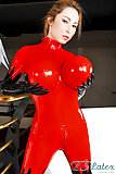 Shemale in latex catsuit with enormous boobs