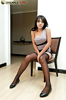 Ladyboy jerks off in her black stockings