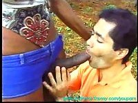 Balck Tgirl eats a dude outdoor
