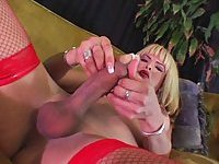Posh Busty Blonde In Red Stockings Cumming