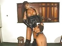 Shemale in latex licking and fucking her slaves ass