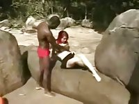Redhead tranny rides black cock outdoors