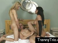 Latino guy rides tranny cock while sucking another