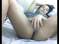 Sexy and cute brunette fingers her ass and spreads her buttcheeks