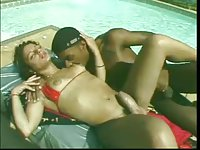 Interracial sex by a pool