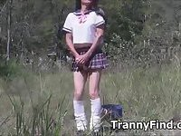 Crossdresser plays outdoors