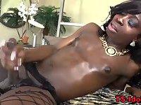 Black tgirl tugs her big cock