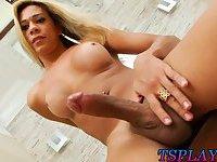 Busty blonde tranny masturbates her cock