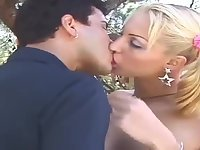 Titty Blonde Shemale Eats a Guy Outdoor