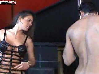 Tranny, guy and a pole