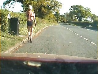 Amateur crossdresser in lingerie on a road