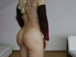 Dancing crossdresser shows off her ass