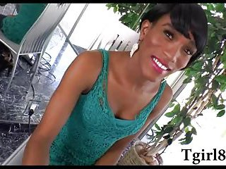 Ebony shemale with a small tits and a semi short hair strips off