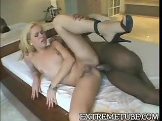 Small tits blonde tranny gets stuffed with black cock