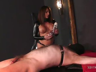 Crossdresser worships cum soaked strapon after wanking and cock pumping